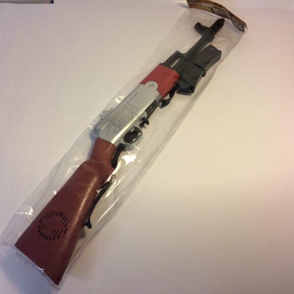 Strzelba hukowa z paskiem i magazynkiem
